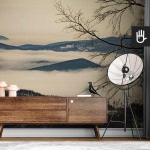 wnętrze nowoczesnego salonu z brązową komodą na tle fototapety Beskidy we mgle
