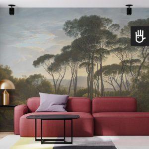 Salon z czerwoną kanapą na tle fototapety z włoskim krajobrazem i drzewami na tle nieba