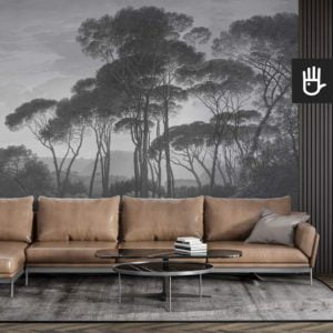 Stylowy męski salon ze skórzaną kanapą na tle ściany z fototapetą Włoski Krajobraz w odcieniach zieleni i błękitu
