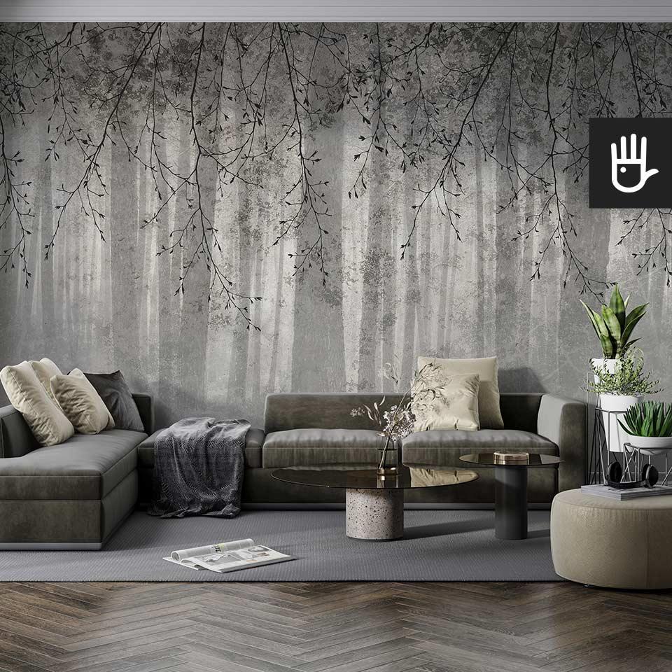 Nowoczesny salon w szarej tonacji z tapetą z gałęziami i widokiem lasu o fakturze i kolorze betonu