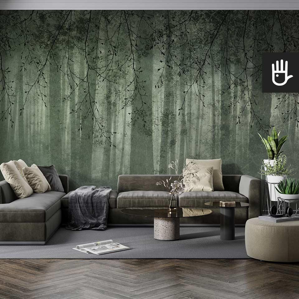 Nowoczesny salon w szarej tonacji z tapetą z gałęziami i widokiem lasu o fakturze betonu i kolorze butelkowej zieleni